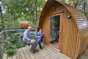 Happy Glampers at a Glamping Pod.