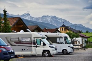 RV campers parked in mountains and chalets